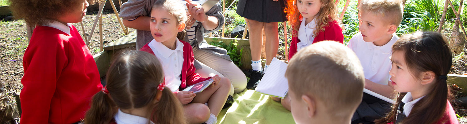 Charter Schools - Children at school story time outside